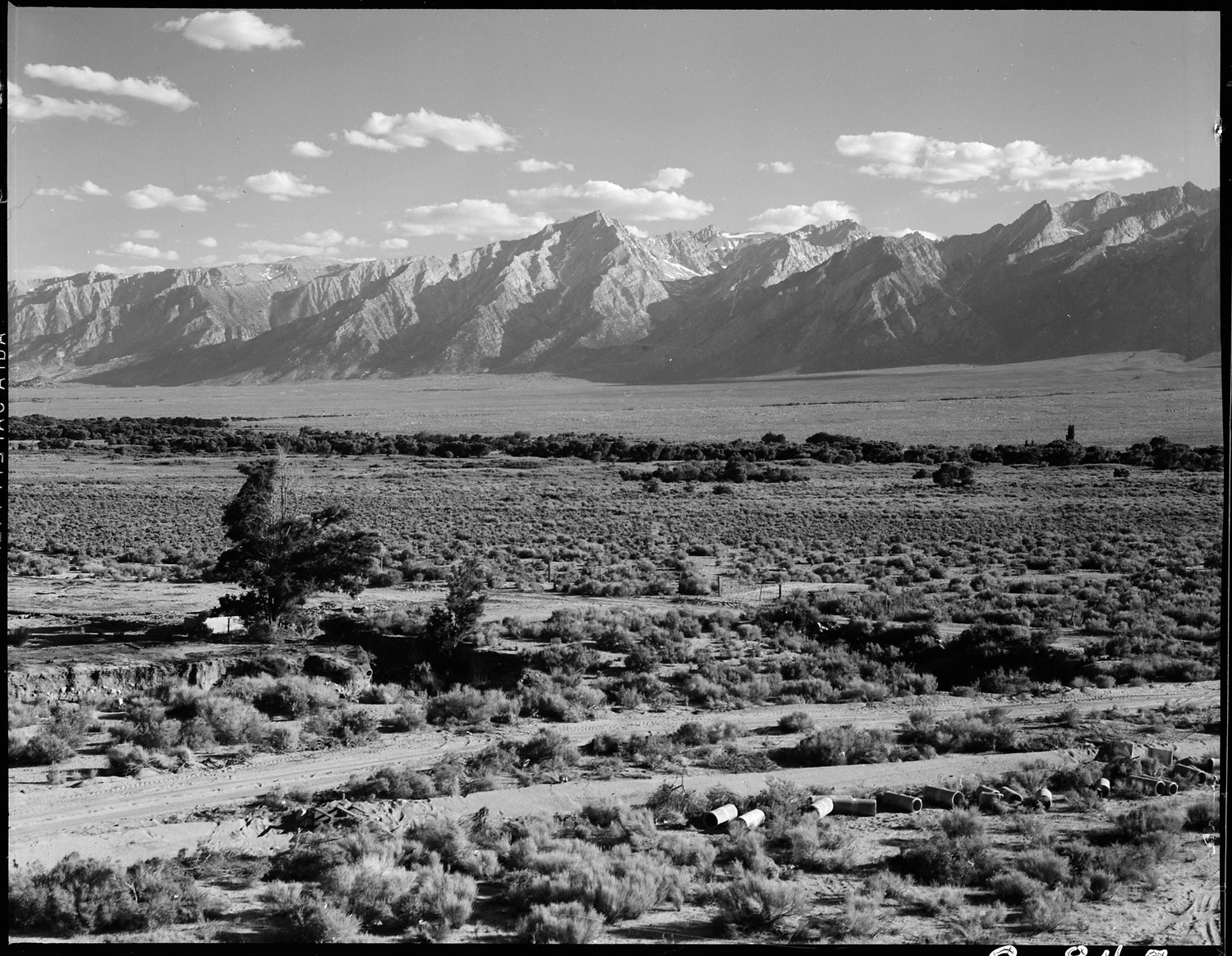 Manzanar Relocation Center, Manzanar, California. A view of surrounding country flanked by beautiful mountains at this War Relocation Authority center.