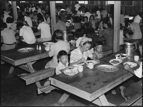 Manzanar Relocation Center, Manzanar, California. Mealtime in one of the messhalls at this War Relocation Authority center for evacuees of Japanese ancestry.