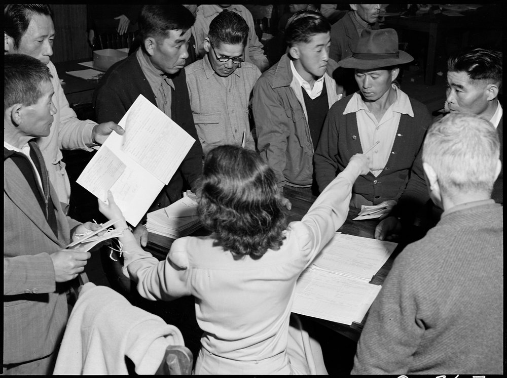 Byron, California. These field laborers of Japanese ancestry at Wartime Civil Control Administration Control Station are receiving final instructions regarding their evacuation to an Assembly center in three days.
