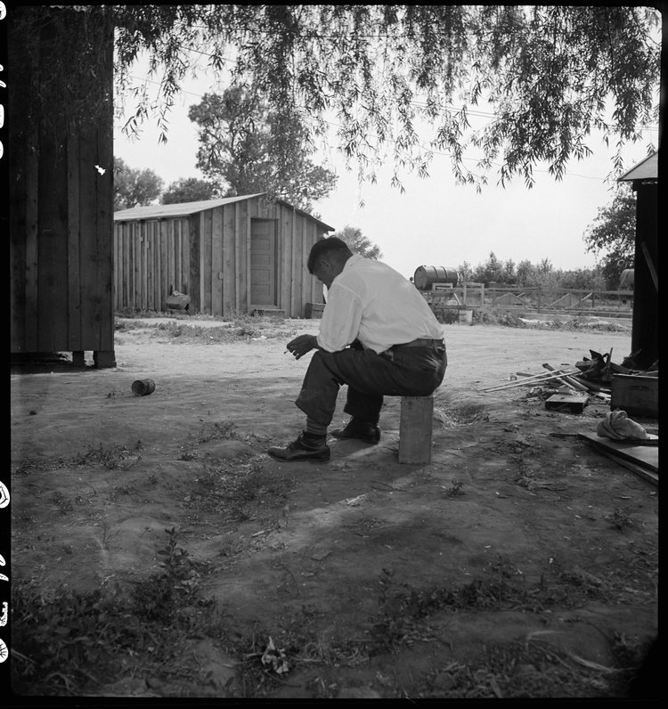 Woodland, California. Tenant farmer of Japanese ancestry who has just completed settlement of their affairs and everything is packed ready for evacuation on the following morning to an assembly center.