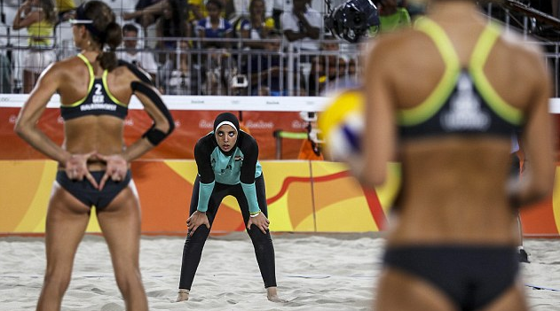 Image: The cover-ups vs. the cover-nots: Egyptian and German beach volleyball players highlight the cultural divide between Western and Islamic women's teams