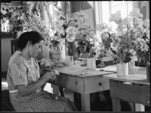 Manzanar Relocation Center, Manzanar, California. Making artificial flowers in the Art School at this War Relocation Authority center for evacuees of Japanese ancestry.