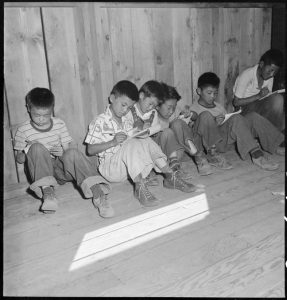Manzanar Relocation Center, Manzanar, California. An elementary school with voluntary attendance has been established with volunteer teachers, most of whom are college graduates. These young evacuees are eager to learn and do not mind the lack of equipment.