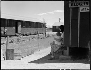 Manzanar Relocation Center, Manzanar, California. Lawns and flowers have been planted by some of the evacuees at their barrack homes at this War Relocation Authority center.