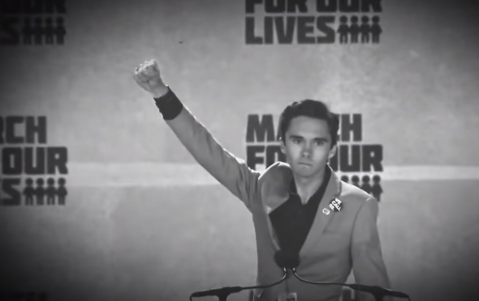 Hypocrite David Hogg marches in protest against NRA alongside his own personal armed guards – watch at Brighteon.com